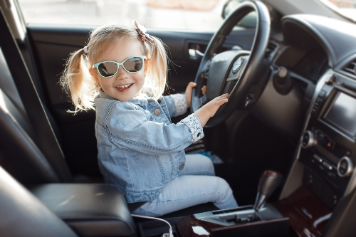 small child in drivers seat