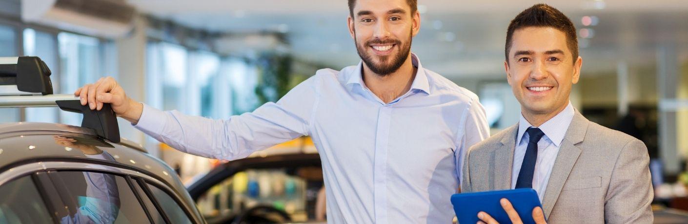 men buying car at a dealership