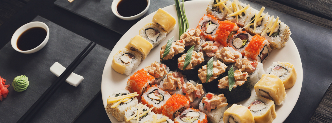 Large Serving of Different Sushi with Soy and Wasabi