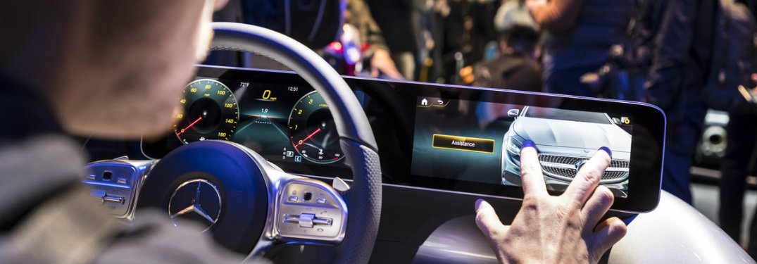 person experimenting with the Mercedes-Benz User Experience infotainment system at CES 2018