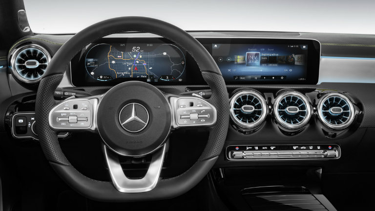 front view of the Mercedes-Benz User Experience infotainment system and steering wheel of the new Mercedes-Benz A-Class
