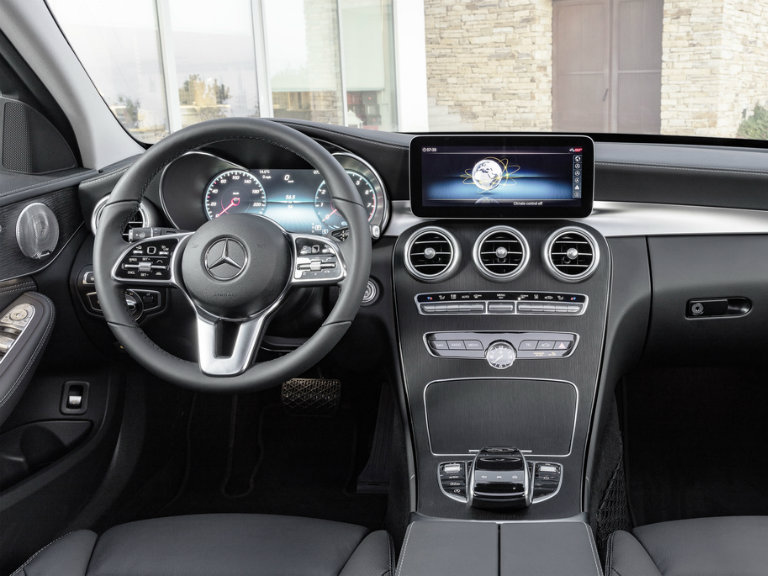 steering wheel and infotainment system of the 2019 Mercedes-Benz C-Class
