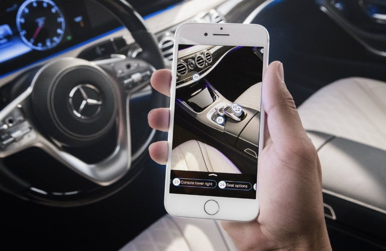 checking out center console features with the Ask Mercedes app