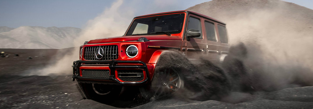 2019 Mercedes-AMG G 63 driving through dust