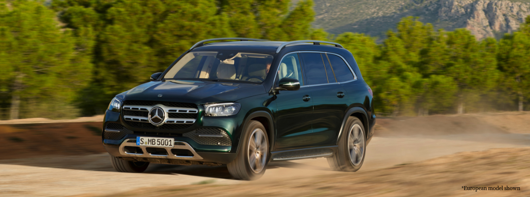 Green European 2020 Mercedes-Benz GLS driving on dirt