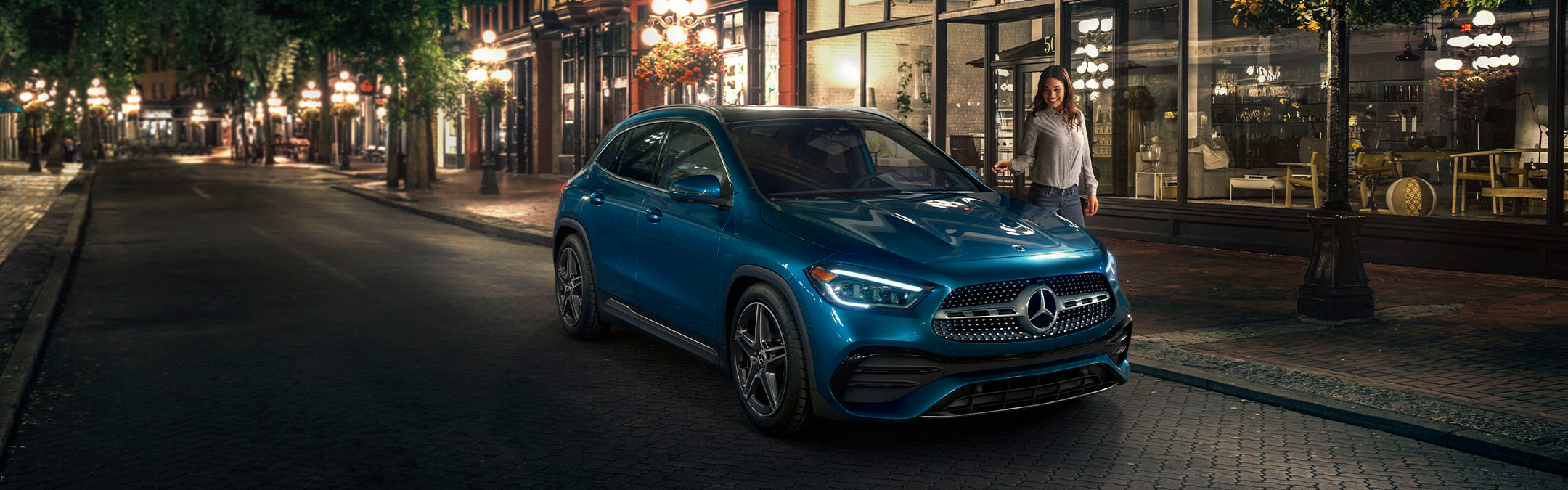 2021 Mercedes-Benz GLA poarked on road with woman locking doors