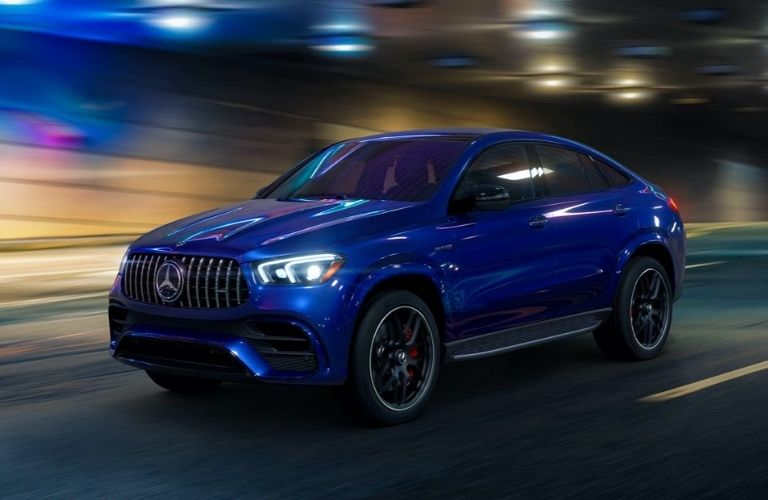 Blue Mercedes-Benz GLE Coupe driving on highway tunnel