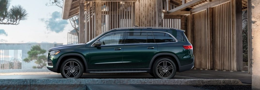 2021 Mercedes-Benz GLS Emerald Green Metallic parked outside the building