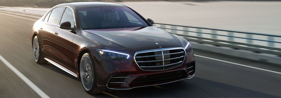 2021 Mercedes-Benz S-Class Rubellite Red Metallic moving on the road
