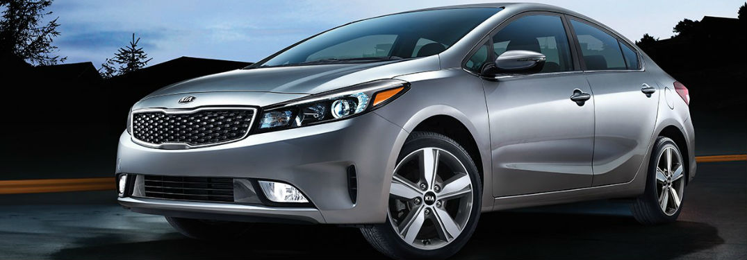 Exterior Side View and Front End View of the 2018 Kia Forte in Gray