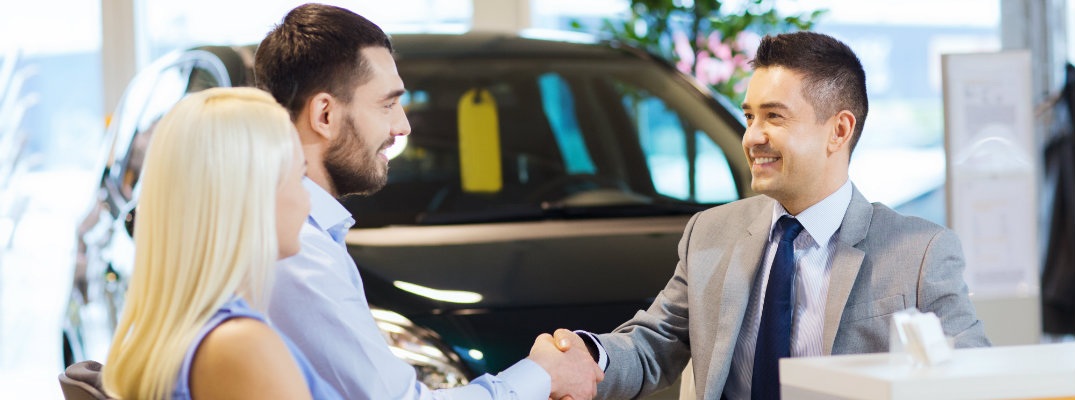 Customer and salesperson shaking hands