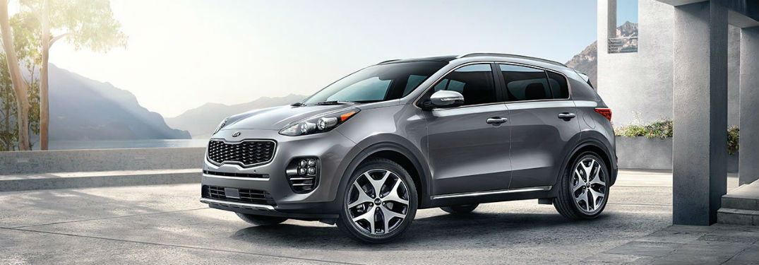 2019 Kia Sportage exterior front fascia and drivers side on stone patio cement pillars