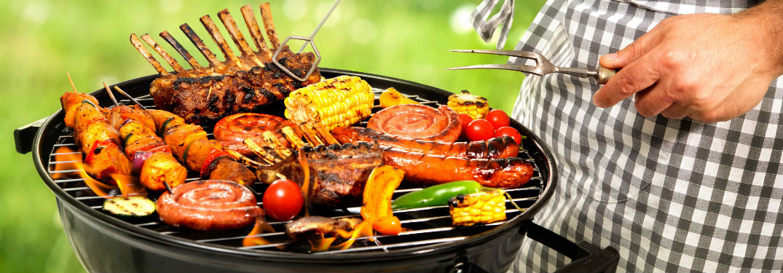 man grilling kebabs meat and veggies