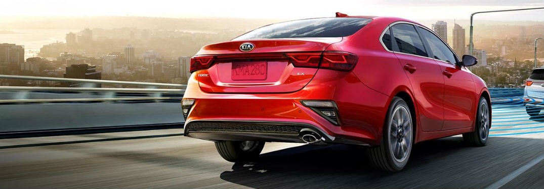 2019 Kia Forte exterior back fascia and passenger side going fast on city highway