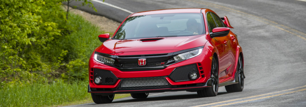 Red 2017 Honda Civic Type R driving on a curved road