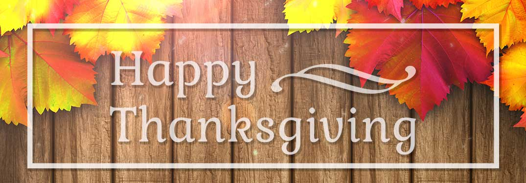 the words Happy Thanksgiving with a wood-pattern and leaves background