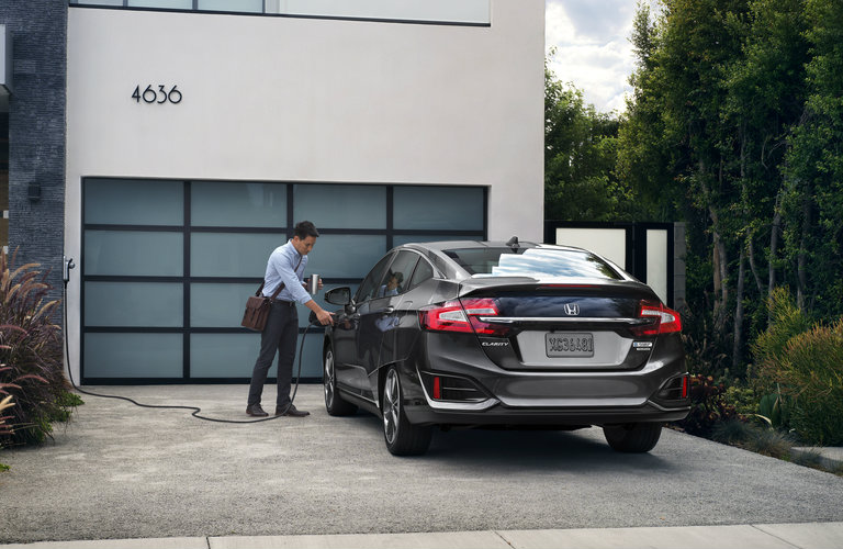 2018 Honda Clarity Plug-in Hybrid getting charged in the driveway