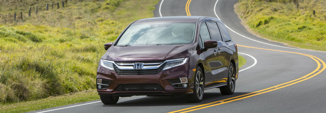2019 Honda Odyssey driving on a curvy road
