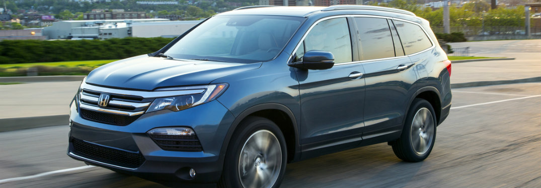 side view of a 2018 Honda Pilot on the road