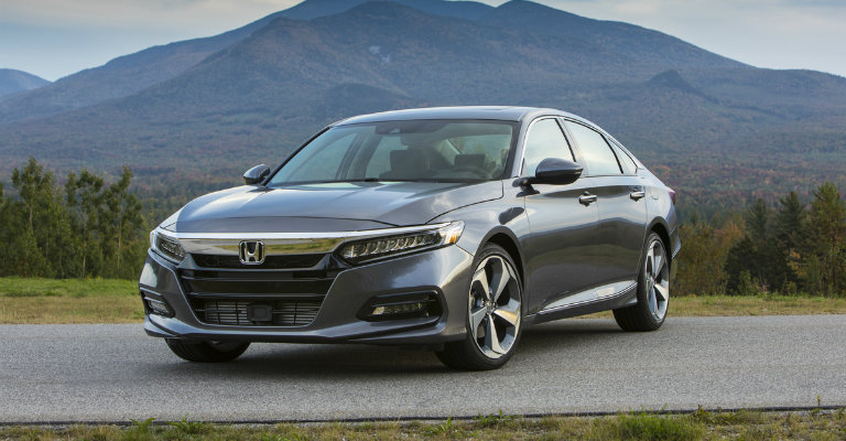 profile view of the 2018 Honda Accord, backdrop of mountains