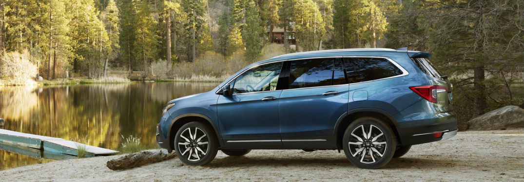 side view of a 2019 Honda Pilot parked by a lake