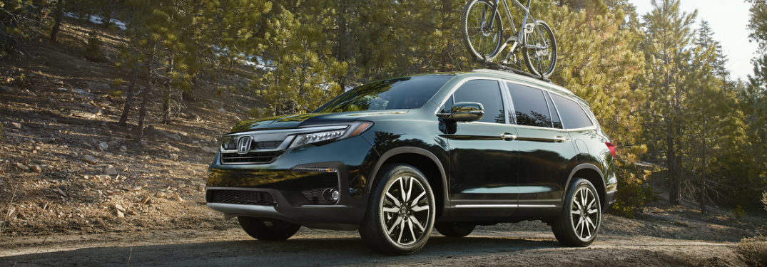 2019 Honda Pilot in the forest with a bike