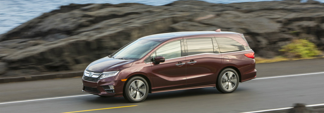 2019 Honda Odyssey on the road, side view