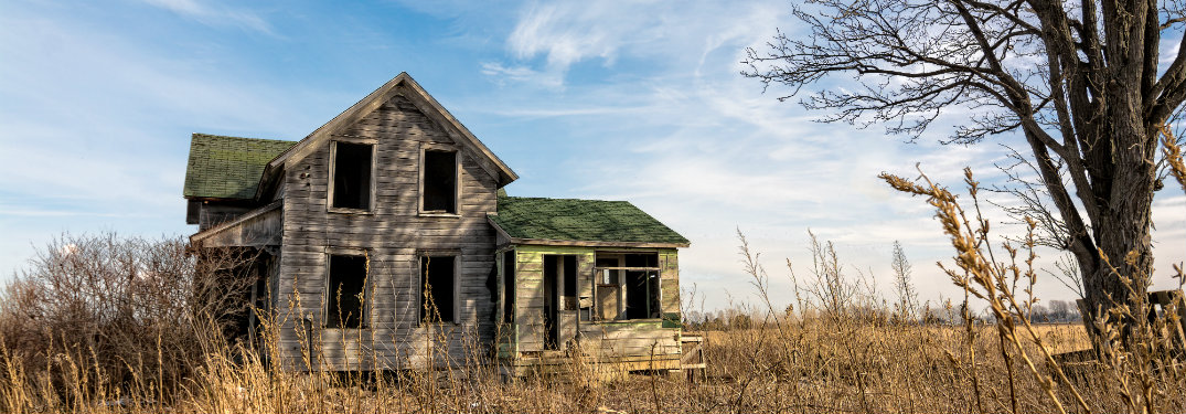 abandoned house in the middle of a field