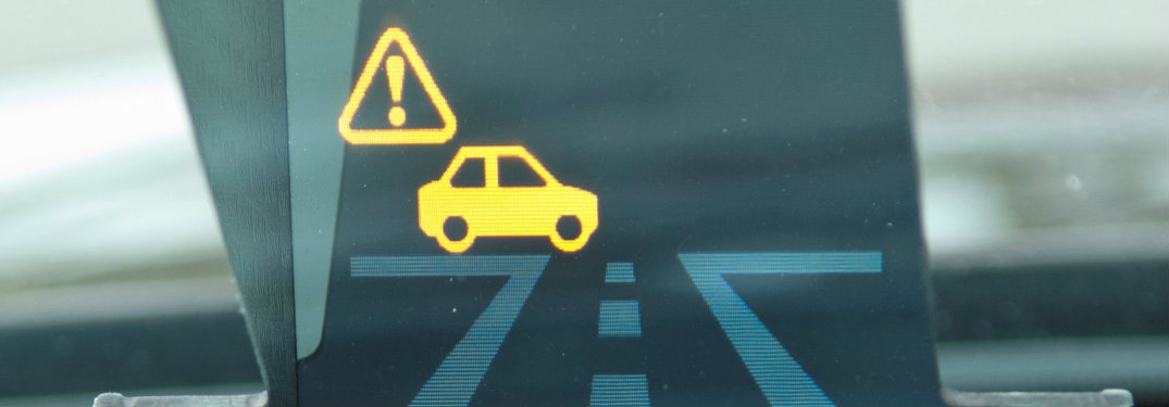 vehicle head-up display with a tiny car and a warning