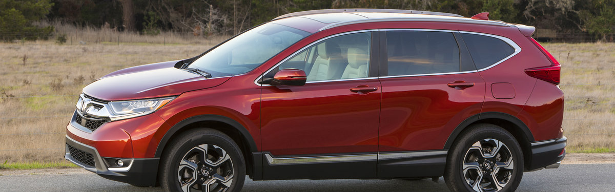 side view of a red 2017-2019 Honda CR-V