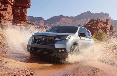 2019 Honda Passport exterior front fascia and drivers side splashing through puddle