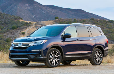 2019 Honda Pilot exterior front fascia and drivers side parked near mountains