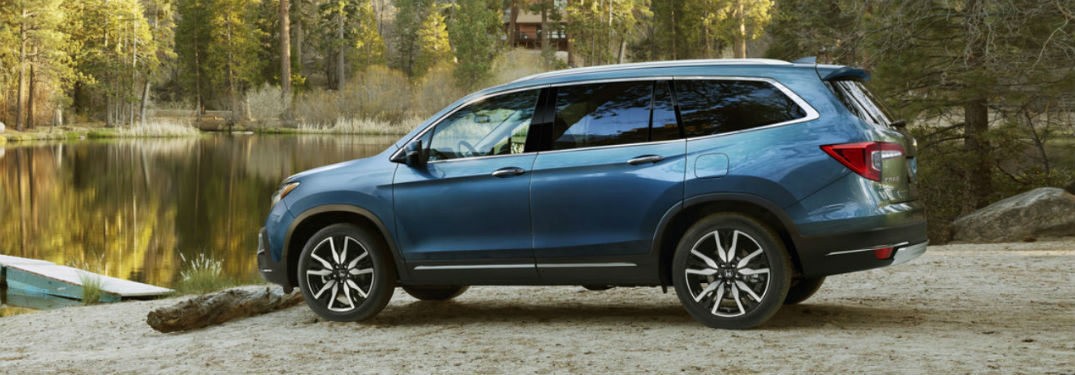 2019 Honda Pilot exterior drivers side profile parked by lake