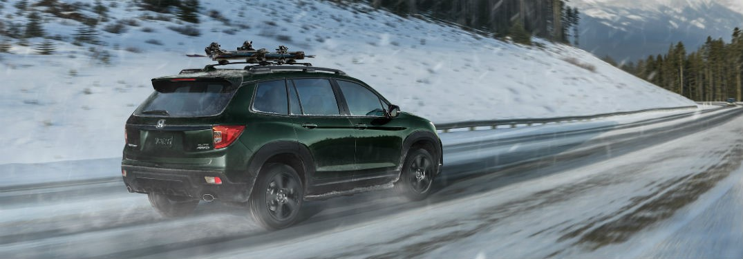 2019 Honda Passport exterior back fascia and passenger side on snowy road