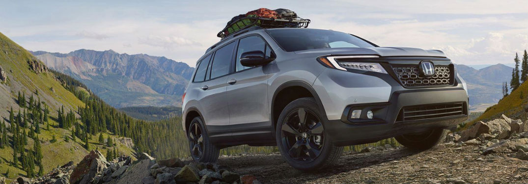 2019 Honda Passport exterior back fascia and passenger side with cargo on top
