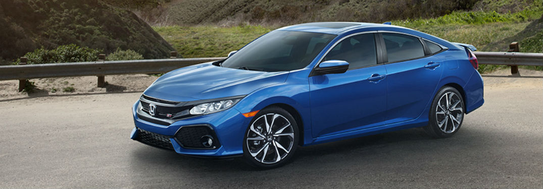2019 Honda Civic Si Sedan exterior front fascia drivers side on bridge in front of large hill