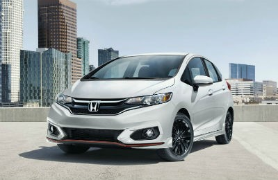2019 Honda Fit exterior front fascia and drivers side parked in lot in front of city