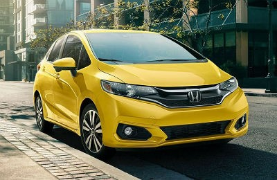 2019 Honda Fit exterior front fascia and passenger side parked on- of town road