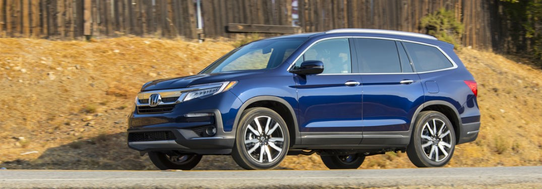 2019 Honda Pilot exterior front fascia and drivers side on road with dead grass