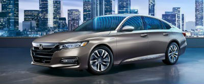 2019 Honda Accord Hybrid exterior front fascia and driver side with city background