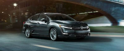 2019 Honda Clarity Plug-In Hybrid exterior front fasica passenger side going fast blurred highway