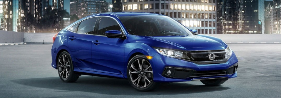 2019 Honda Civic Sedan exterior front fascia and passenger side in city at night