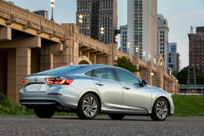 2020 Honda Insight exterior back fascia and passenger side in front of city bridge