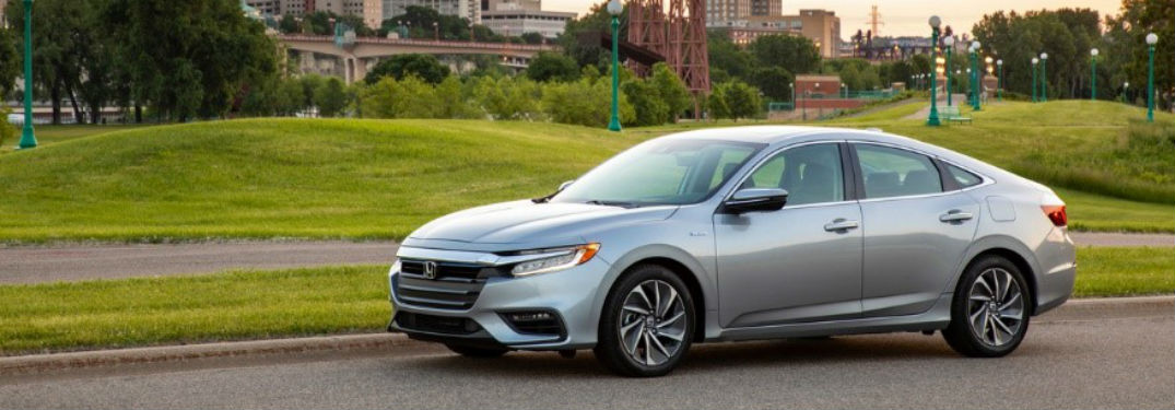 2020 Honda Insight exterior front fascia and driver side in front of house with yard