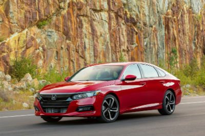 2019 Honda Accord exterior front fascia and driver side in front of rock wall