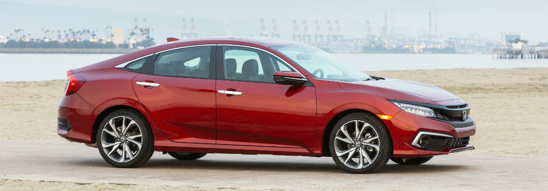 2019 Honda Civic exterior front fascia and passenger side on beach