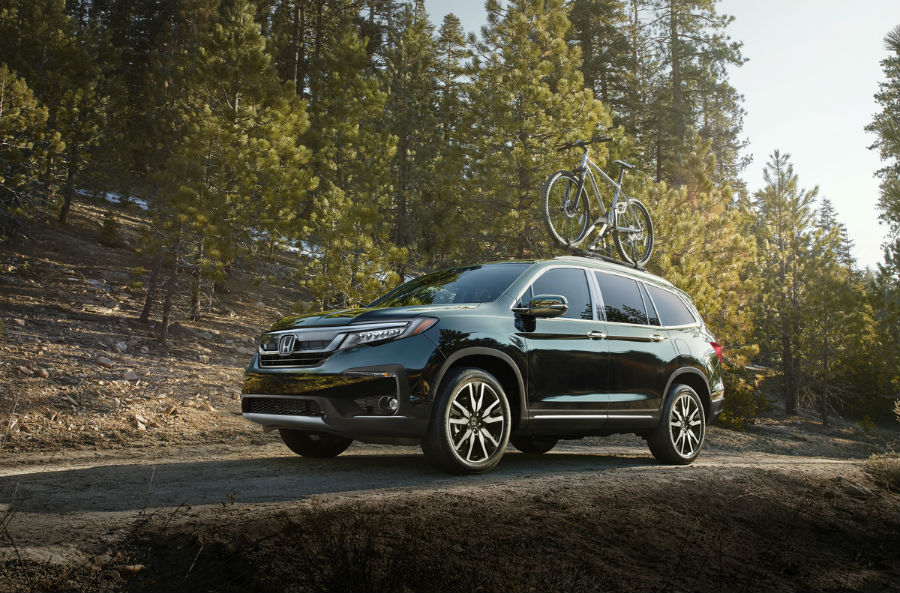 2019 Honda Pilot exterior front fascia and driver side with bike on roof in wood