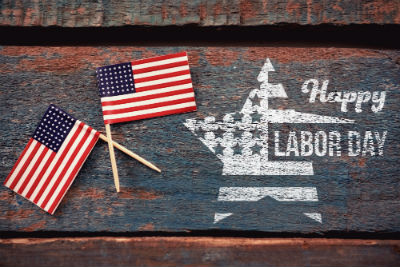 Happy Labor Day with white star and 2 flags on wood