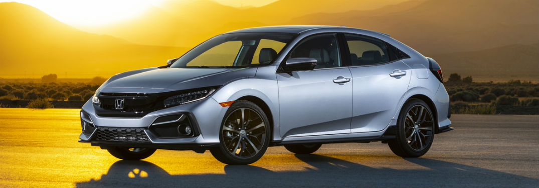 2020 Honda Civic Hatchback Sport Touring exterior front fascia and driver side in front of sunset