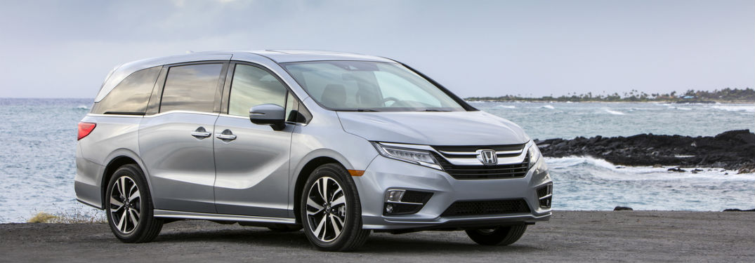2020 Honda Odyssey exterior front fascia and passenger side in front of lake